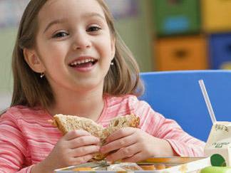 first_grader-eating-sandwich